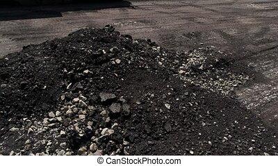 Milled asphalt pile.