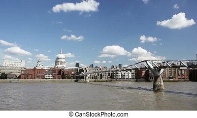Millenium Bridge and St. Paul's - People crossing the...