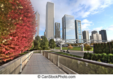 Beautiful Jay Pritzker Pavilion and The Nichols Bridgeway in Millenium Park on a sunny fall day in Chicago