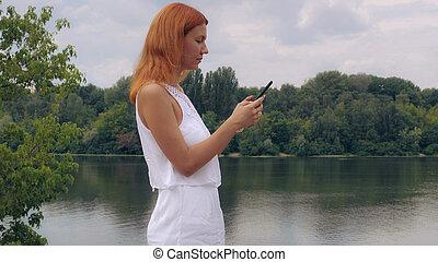 Millennial chatting in social media app.