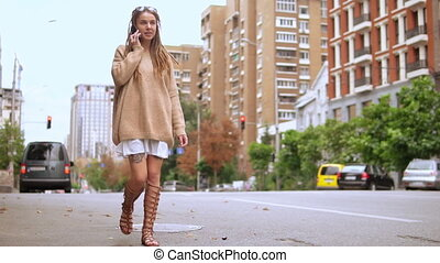millennial girl using smartphone outdoor - happy hipster...