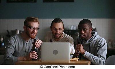 Millennial guys friends buddies supporters watching online...