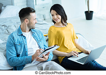 Millennial man and woman talking while reuniting over project together