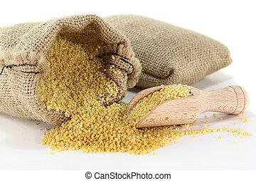 Millet - a sack of millet on a light background