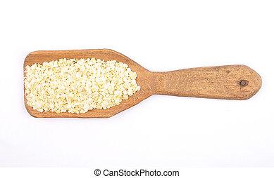 Millet flakes on shovel