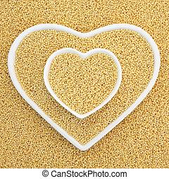 Millet Grain - Millet grain super food in heart shaped bowls...
