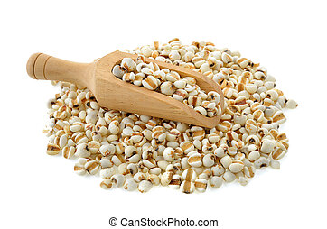 Millet in wood scoop on white background