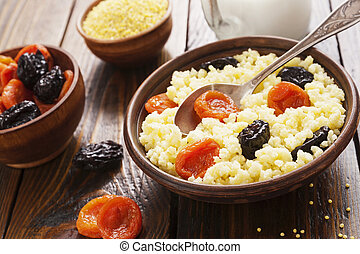 Millet porridge with dried fruits