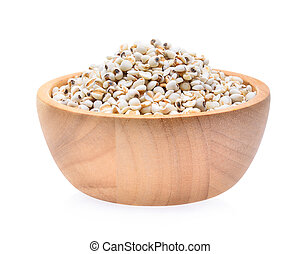Millet rice , millet grains in wooden bowl isolated on white background