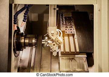 Milling cutting metalworking process at industrial CNC machining of metal factory