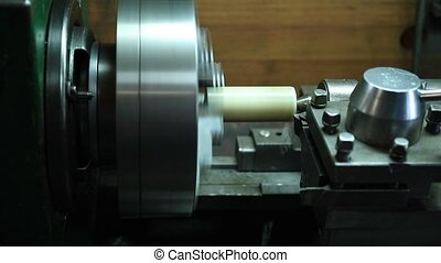 Milling detail on metal cutting machine tool - Side view of...