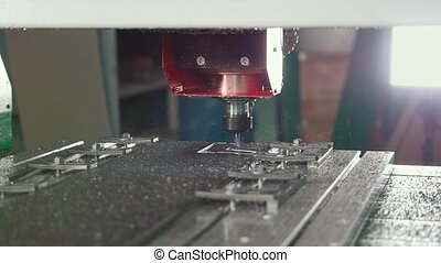Milling machine carving metal item, industrial concept