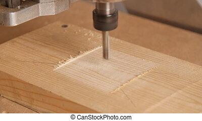 Milling machine handles wood