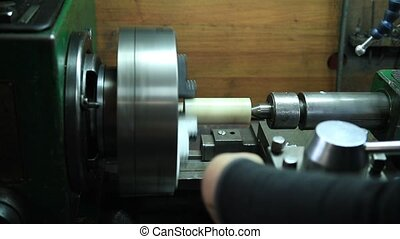 Milling machine operator working in the workshop