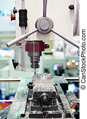 Milling machine processes the part