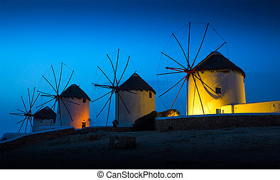 Mills on the Greek island in the sunset