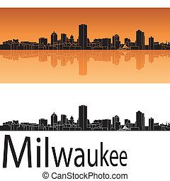 Milwaukee skyline in orange background in editable vector ...