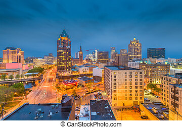 Milwaukee, WIsconsin, USA downtown skyline at dusk.