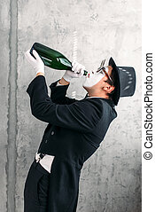 Mime actor drinking from a big bottle