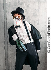 Mime actor performing a drunk man