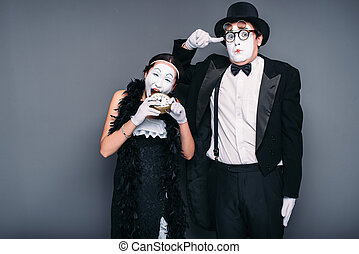 Mime actors performing, actress nibble alarm clock....