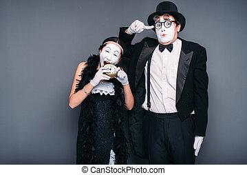 Mime actors performing, actress nibble alarm clock. ...