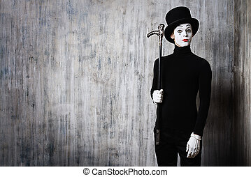 mime and a stick - Elegant expressive male mime artist...