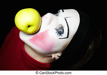 mime biting an apple on a black background