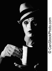 mime clown holding white cup - Portrait of terrible mime...
