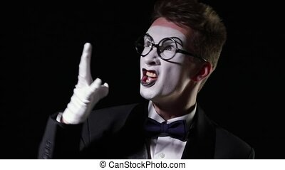 mime emotionally shouts at someone - mime in a tuxedo with...