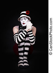 Mime in a white hat