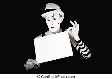 mime in striped gloves and hat, holding a white  blank