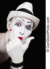 mime in striped gloves and white hat