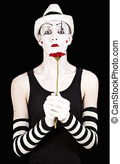 mime in white hat with red gerberas
