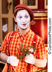 Mime on the street waiting to meet with his lover - Clown on...