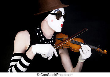 mime playing on small violin in sunglasses on black background