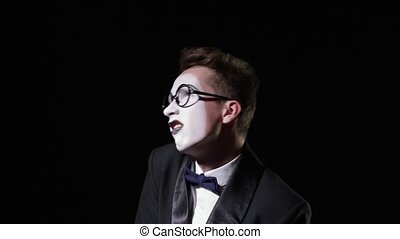 mime shakes and then suddenly stops - mime in a tuxedo with...