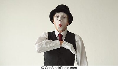 MIME takes from his pocket a credit card. Manipulation of credit cards on white background