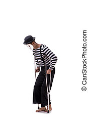 Mime with crutches isolated on white background