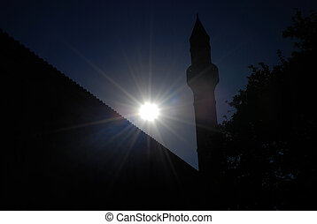 Minaret and dusk - Islamic minaret tower and setting sun...