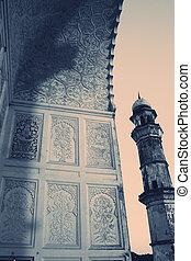 Minaret of an ancient muslim mausoleum, India.