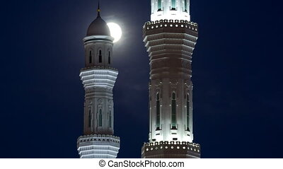 Minarets of The Hazrat Sultan Mosque in Astana timelapse at night with full moon, Kazakhstan