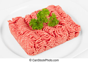 mince meat - fresh mince with herbal on white plate
