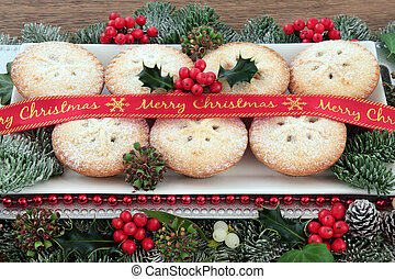 Mince Pie Treats - Mince pie cakes on a plate with red merry...