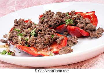 mince stuffed peppers on a white plate