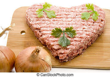 Minced meat in the heart outline