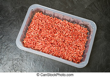 Minced meat on a black background. Place for your text.