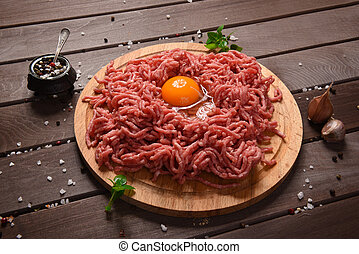 minced meat on a wooden desk - minced meat on a rustic...