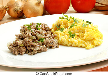 Minced meat with turmeric rice on a white plate