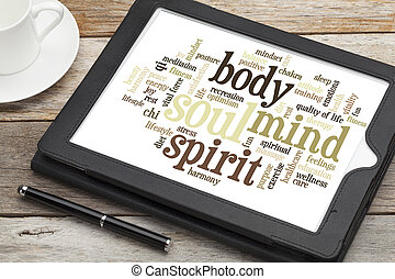 mind, body, spirit and soul - word cloud on a digital tablet...